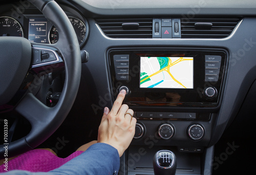 Woman using navigation system while driving a car Fototapeta