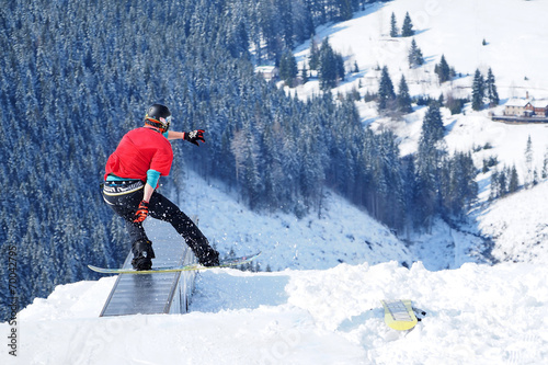 Fotografie, Obraz  Young snowboarder enjoys winter vacation and fun in the snow.