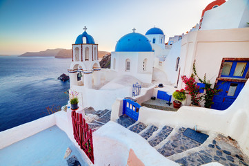 Oia town on Santorini island, Greece at sunset. Aegean sea.