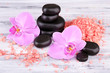 Pink tropical orchid flowers and spa stones