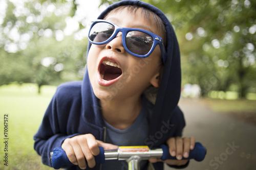 Fényképezés  Boy riding a bike with shouting
