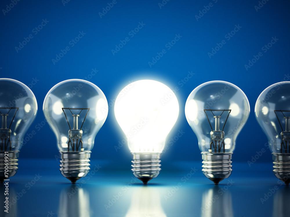 Fototapety, obrazy: One lit bulb among unlit ones