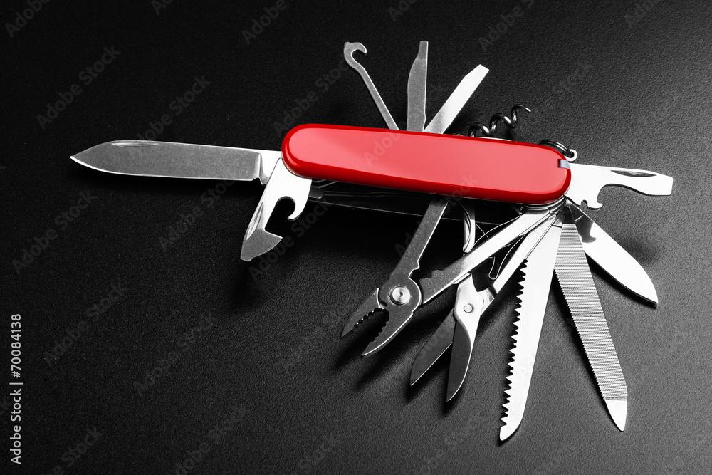 Fototapeta Pocket Swiss knife fully opened