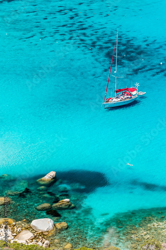Photo  Sailboat anchored in Porto Giunco bay. Sardinia Island. Italy.