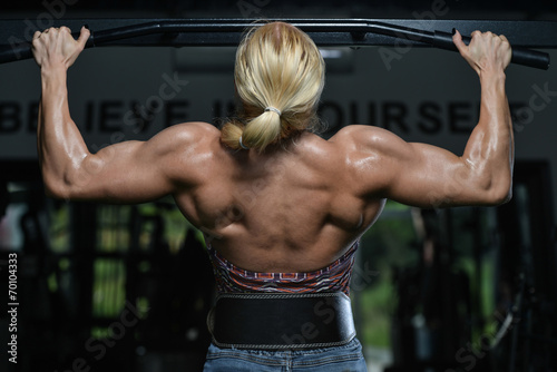 Young Female Doing Back Exercises In The Gym Wallpaper Mural