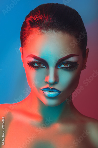 Obraz w ramie Glamour adult brunette with make up in red and blue lights