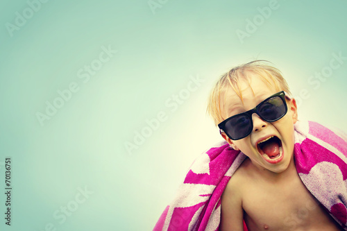 Photo  Excited Child in Beach Towel on Summer Day