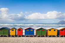Row Of Brightly Colored Huts In Muizenberg Beach. Muizenberg