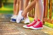 Sneakers of teenage boys and girls