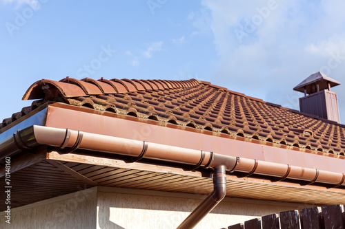 Fotografie, Obraz  Red tiled roof with gutter and chimney