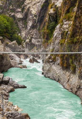 Photo sur Toile Riviere Hanging suspension bridge in Himalaya mountains, Nepal.
