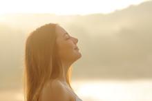 Woman Breathing Deep Fresh Air In The Morning Sunrise