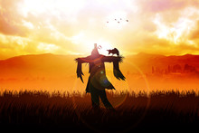 Silhouette Of A Scarecrow On A...