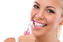 Woman Brushing Teeth Holding T...