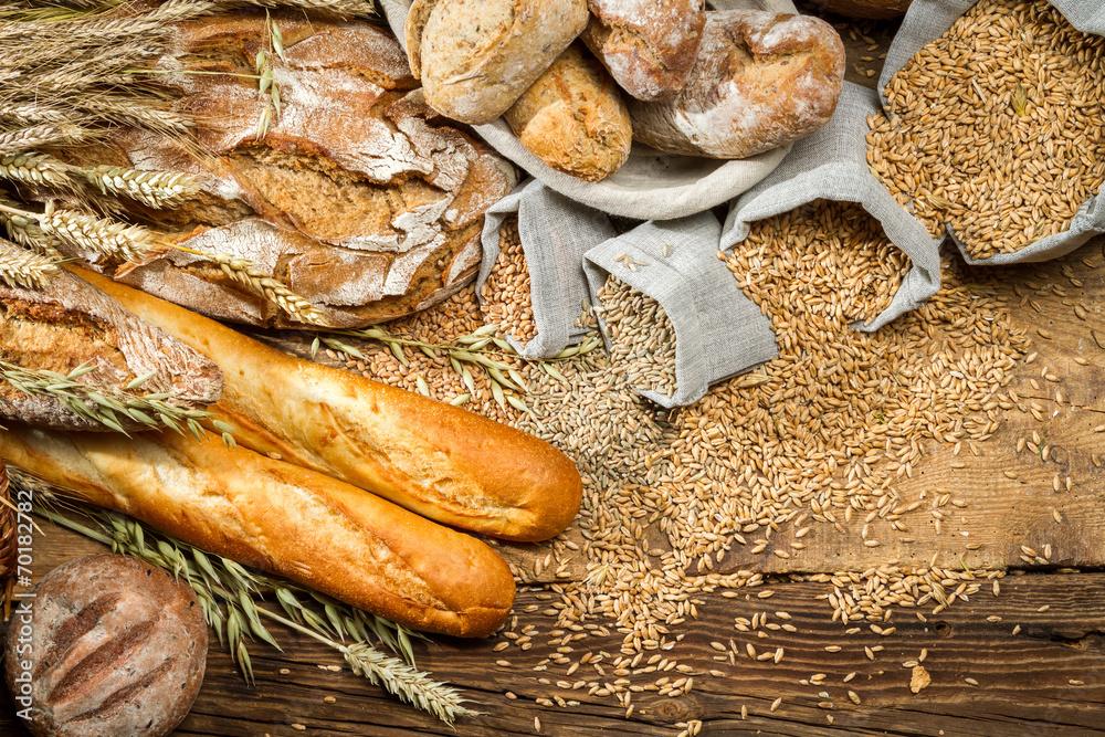 Fototapeta Whole wheat bread on old wooden table