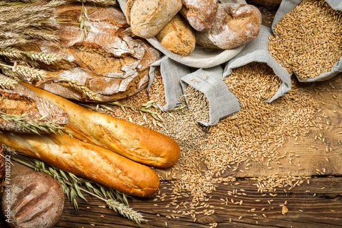 Fototapety, obrazy: Whole wheat bread on old wooden table