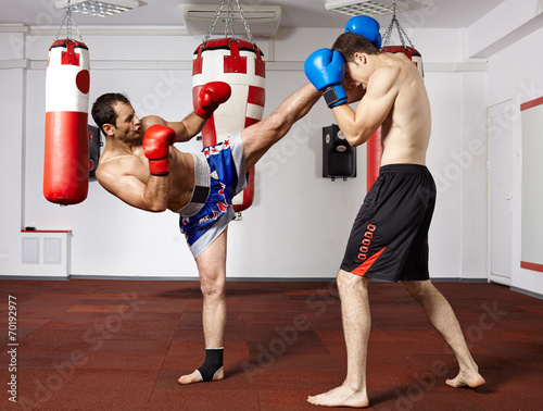 Photo  Kickbox fighters sparring in the gym