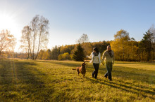 Couple Walk Dog In Countryside...