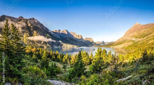 Fotografie, Obraz  Panoramic landscape view of Glacier NP mountain range and lake