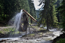 Rodna Mountains In Romania - Water Wheel At Iza River Source