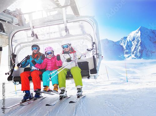 Ski, skiing - skiers on ski lift Canvas Print