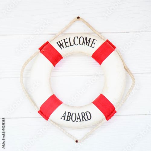 Fotografie, Obraz  White Life buoy with welcome aboard on white wall