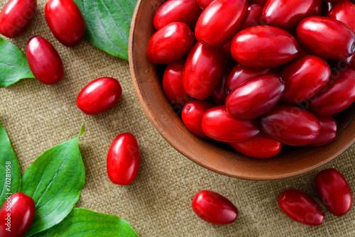 Valokuva  fresh cornel berries in brown bowl