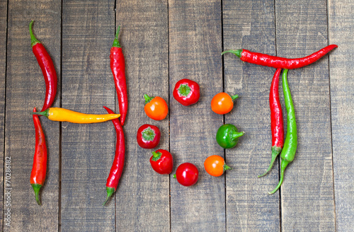 Hot chili peppers on wooden...