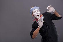 Portrait Of Young Mime Boy Showing Something With His Hands