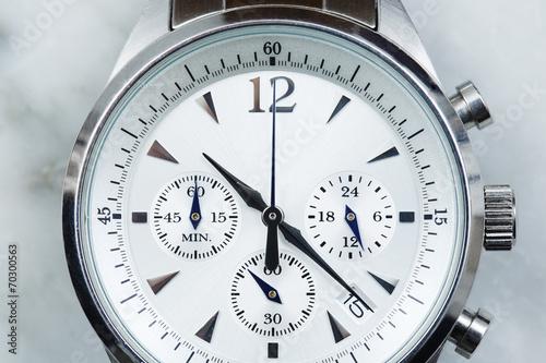 Luxury men's watch face, close up .