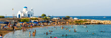PARALIMNI, CYPRUS - 17 AUGUST 2014: Crowded Beach With Tourists