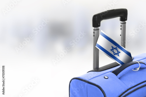 Fotografija  Destination Israel. Blue suitcase with flag.