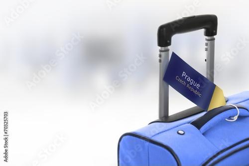 Photo Prague, Czech Republic. Blue suitcase with label at airport.