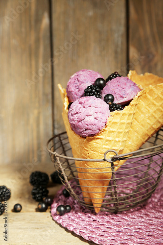 Fotografie, Obraz  Tasty ice cream with berries in waffle cone