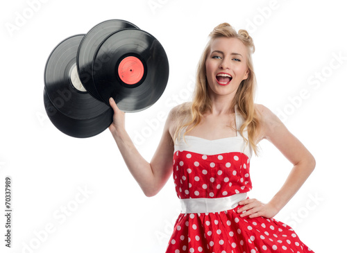 Vászonkép Jubelnde Frau hält Schallplatten