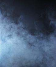 Light Blue Smoke On A Black Background