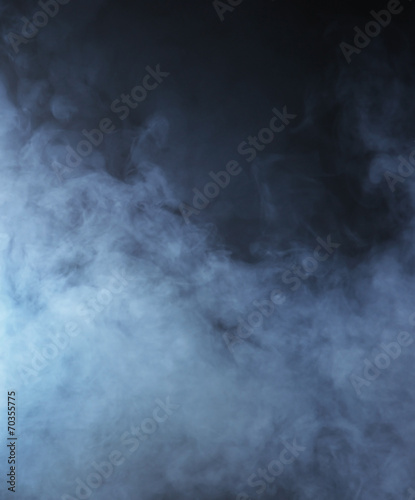Fotobehang Rook Light blue smoke on a black background