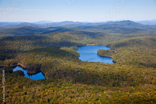 Fotografia, Obraz  Adirondack forests and lakes summer aerial view from light aircr