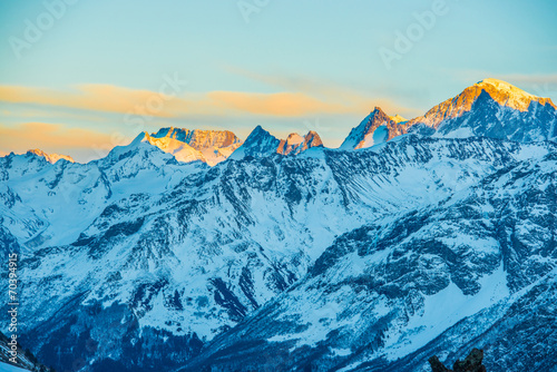 Fototapeta Snowy blue mountains in clouds obraz na płótnie