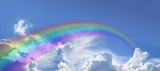 Fototapeta Rainbow - Wide blue sky and huge arcing rainbow