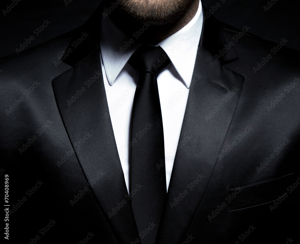 Fototapeta Man gentleman in black suit and tie