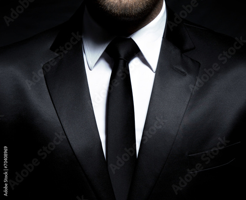 Fotografia  Man gentleman in black suit and tie