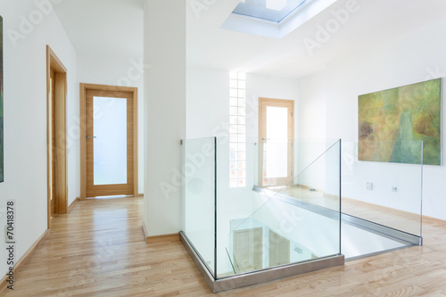 Stairs, glass banister and doors in modern hallway Canvas Print