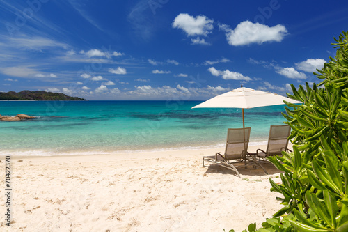 canvas print motiv - 18042011 : Chairs and umbrella on a beautiful tropical beach of Seychelles
