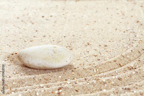 Acrylic Prints Stones in Sand Stack of stones on sand beach
