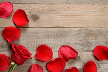 Red Rose And Petals On Wooden ...