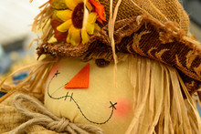Scarecrows With Flowers And Hay