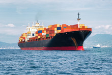 Commercial Cargo Ship Carrying...