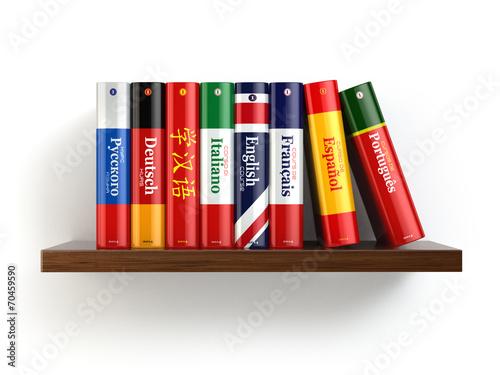 Fotografía  Dictionaries on bookshelf white isolated backgound.