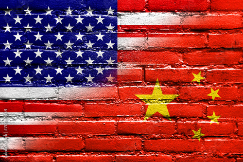 In de dag China China and USA Flag painted on brick wall